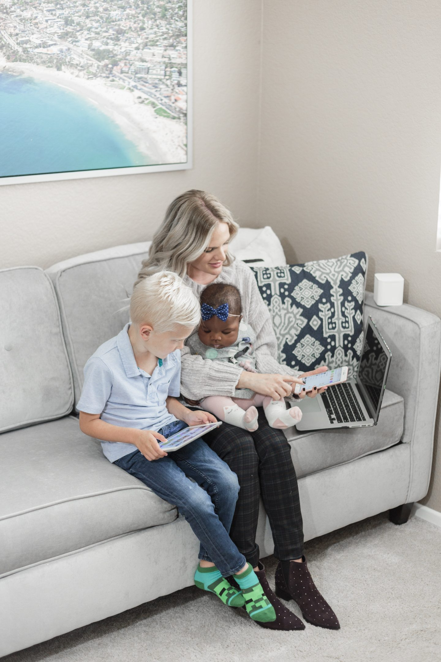 circle with disney review featured by top Orange County life and style blog, Dress Me Blonde: image of a woman holding her baby and watching her son's tablet