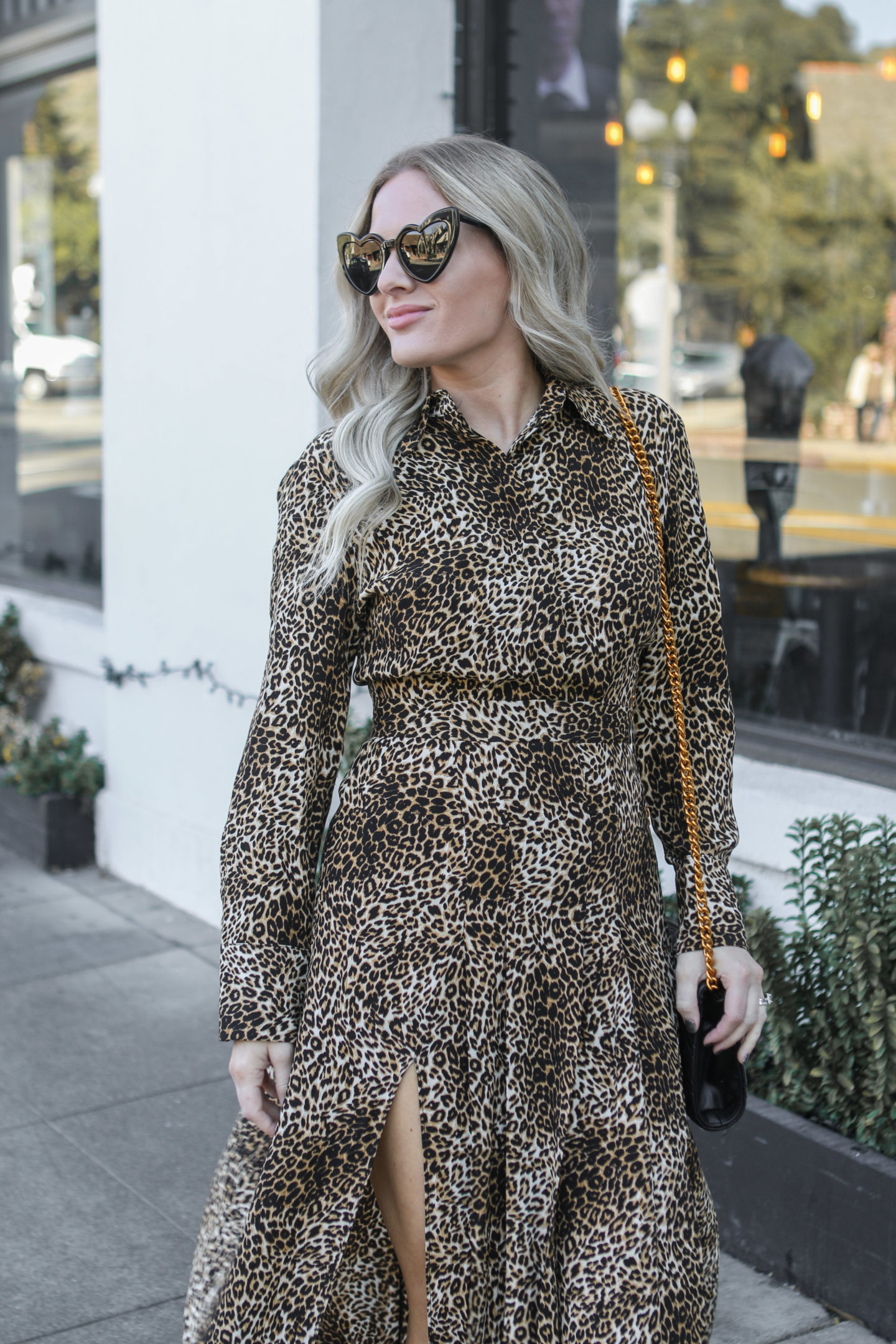 Leopard Print Maxi Dress & Glam Sneakers featured by top US fashion blog, Dress Me Blonde: image of a woman wearing a Topshop leopard maxi dress, YSL heart sunglasses, Golden Goose sneakers, a Gucci shoulder bag and an Anthropologie necklace