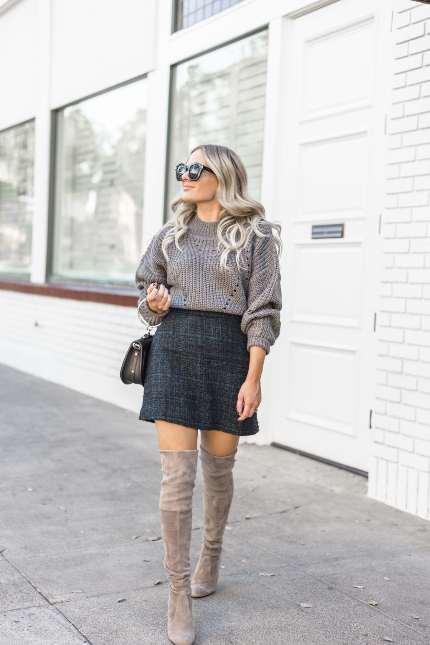 Stylish grey outfit for the winter featured by top US fashion blog, Dress Me Blonde: image of a blonde woman wearing an ASTR sweater, an ABD tweed mini skirt, a CHLOE bracelet bag and Stuart Weitzman over the knee boots
