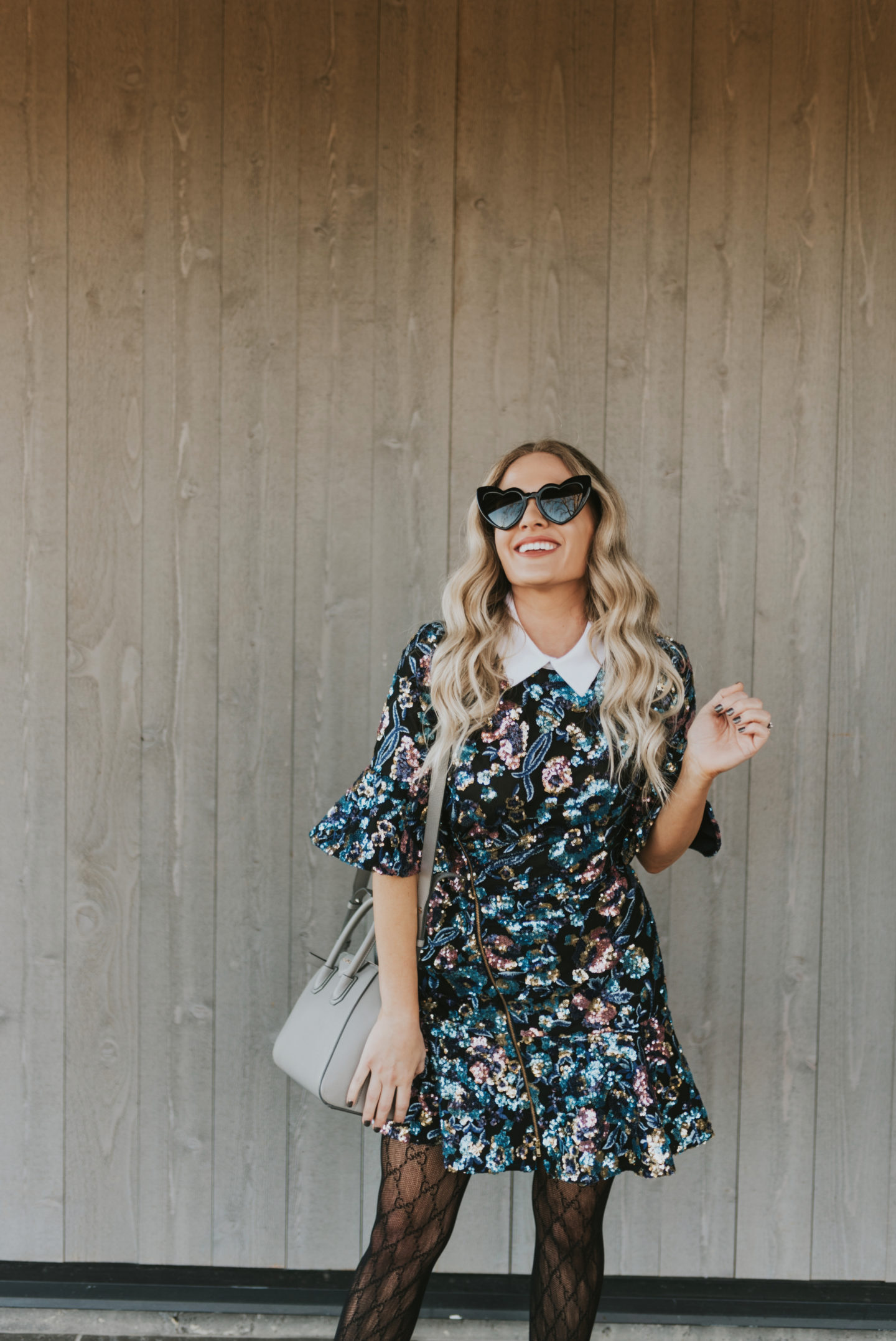 Things do in Sonoma County featured by top US life and style blog, Dress Me Blonde: image of a woman wearing a Self Portrait floral sequin mini dress, Gucci tights, Sam Edelman suede sandals, Saint Laurent heart sunglasses, Givenchy leather satchel