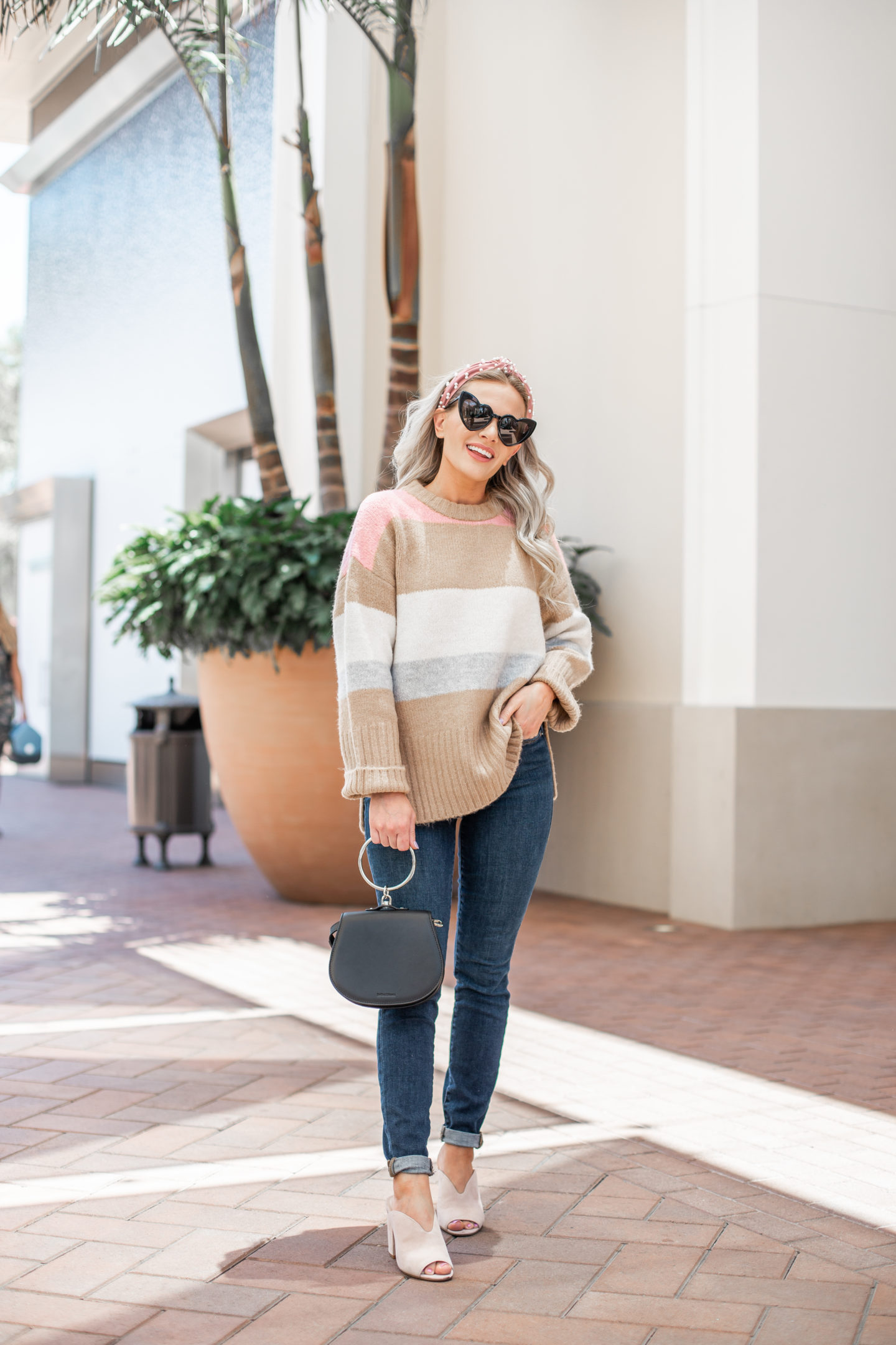 Nordstrom Anniversary Sale: Top Purchases featured by top US fashion blog, Dress Me Blonde: image of a woman wearing a Topshop striped sweater, Good American skinny jeans, BP Gretta sandals, Saint Laurent heart sunglasses, and a BP knot headband
