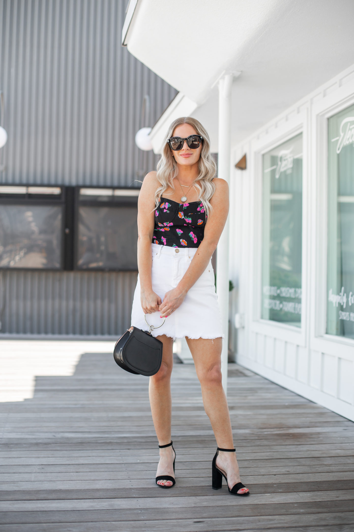 Victoria Emerson Jewelry Christmas in July Sale top picks featured by top US fashion blog, Dress Me Blonde: image of a woman wearing a 7 for all Mankind denim skirt, Chloe bracelet crossbody bag, Sam Edelman strap sandals, WAYF cami tank top and Victoria Emerson pendant necklaces