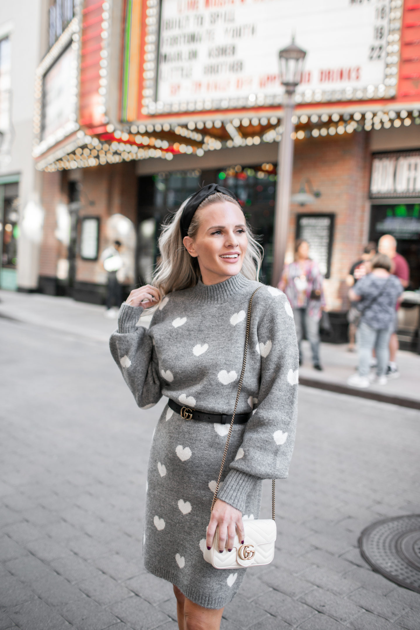 The Perfect Knit Sweater Dress for Valentine's Day styled by top Los Angeles fashion blog, Dress Me Blonde: image of a blonde woman wearing a Lovers + Friends love heart knit sweater dress.
