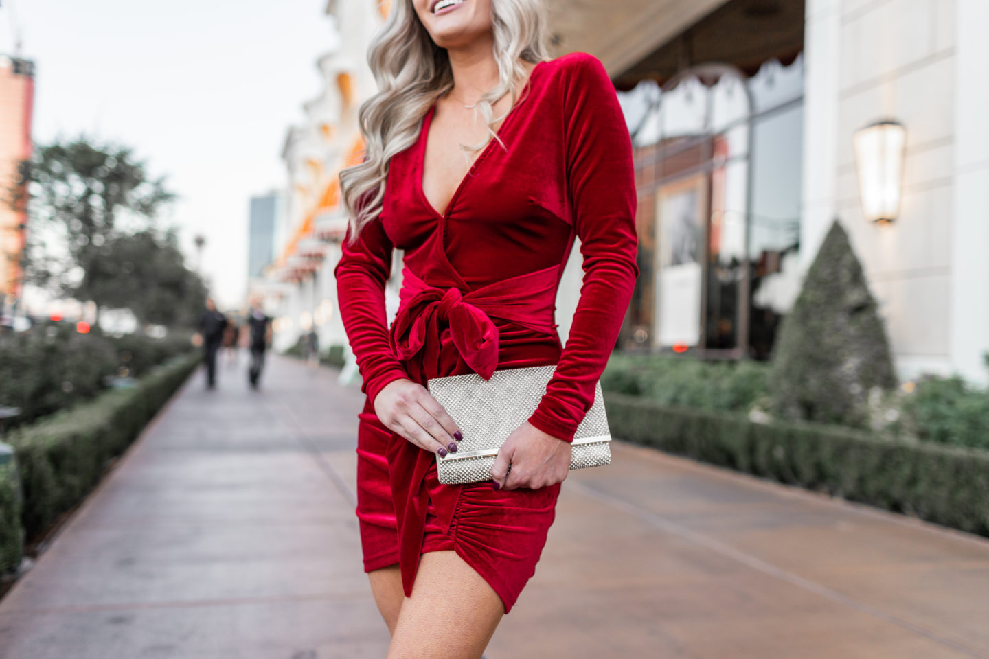 Velvet Holiday Dresses by popular California fashion blog, Dress Me Blonde: image of a woman wearing a Revolve superdown Jaylin Ruched Mini Dress, Nordstrom Sam Edelman Yaro Ankle Strap Sandal, Nordstrom Crystal Mesh Bar Clutch, and Nordstrom 2-Pack Star Crystal Barrettes.