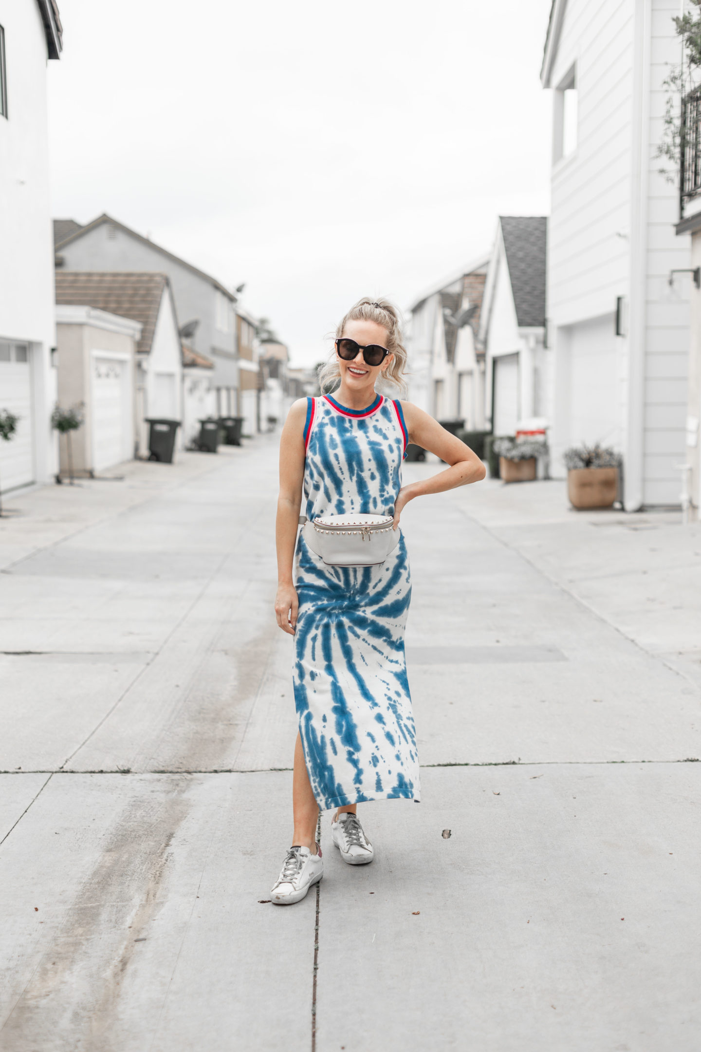Tie Dye Maxi Dresses to Wear for Spring/Summer featured by top L.A. fashion blog, Dress Me Blonde: image of a woman wearing a Sailor NYC tie dye maxi dress
